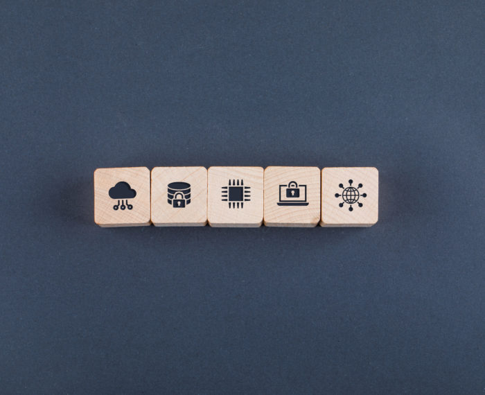 Conceptual of cloud server and business. with wooden blocks with icons on dark color background flat lay. space for text horizontal image